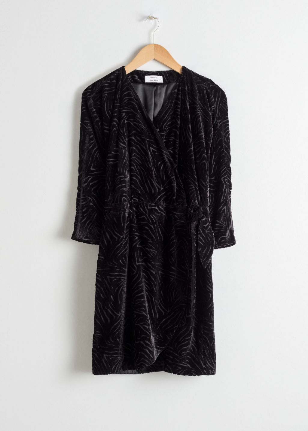 Front image of Stories velvet wrap dress in black