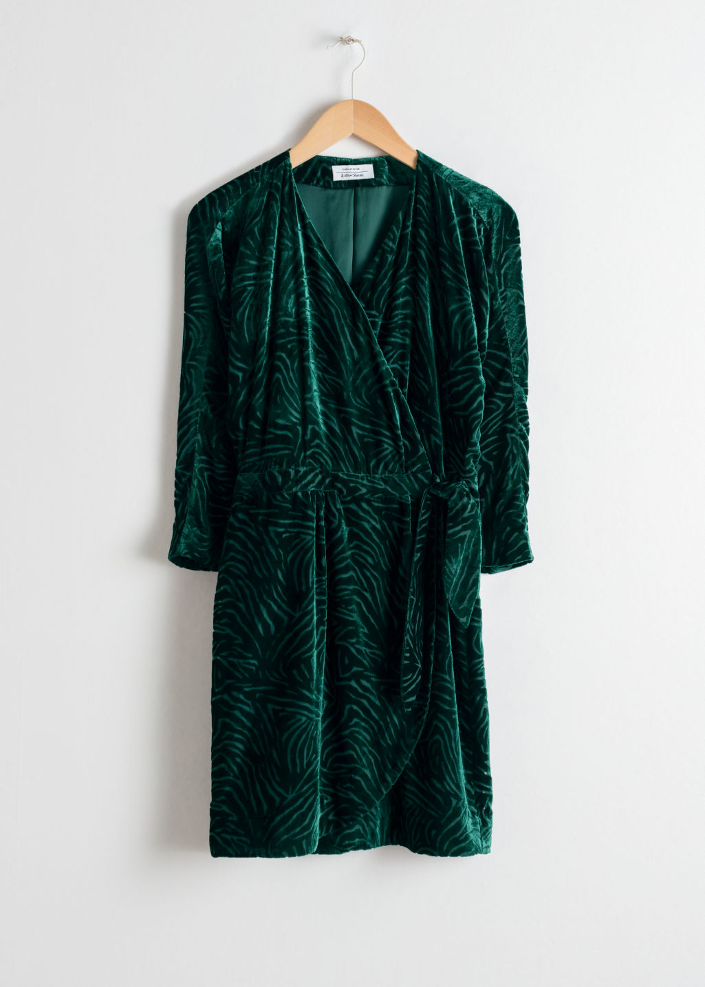 Front image of Stories velvet wrap dress in turquoise
