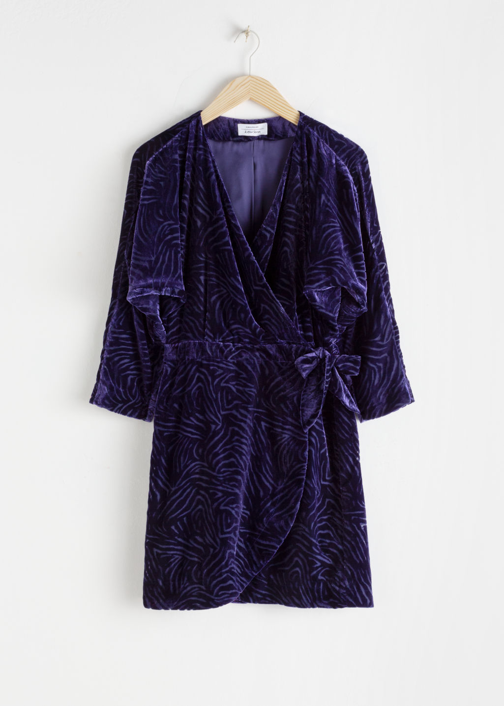 Front image of Stories velvet wrap dress in purple
