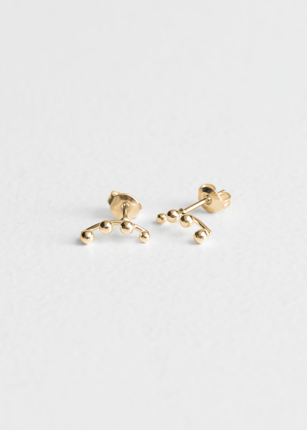 Front image of Stories crawler earrings  in gold