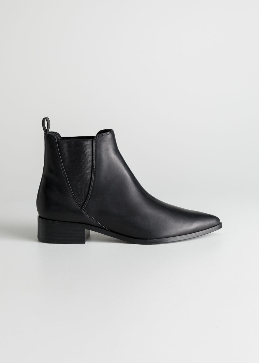 Front image of Stories chelsea boots in black