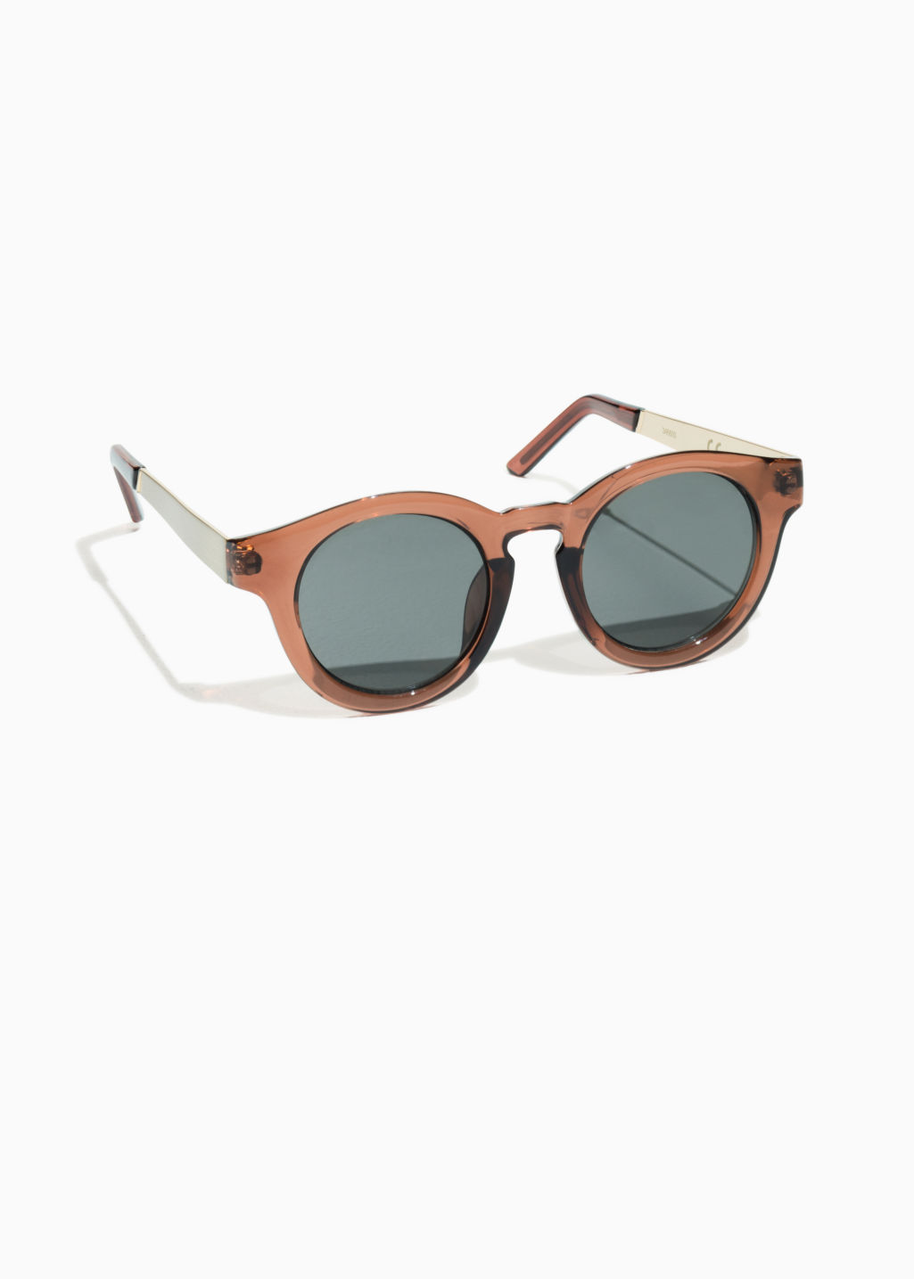 Front image of Stories round sunglasses in beige