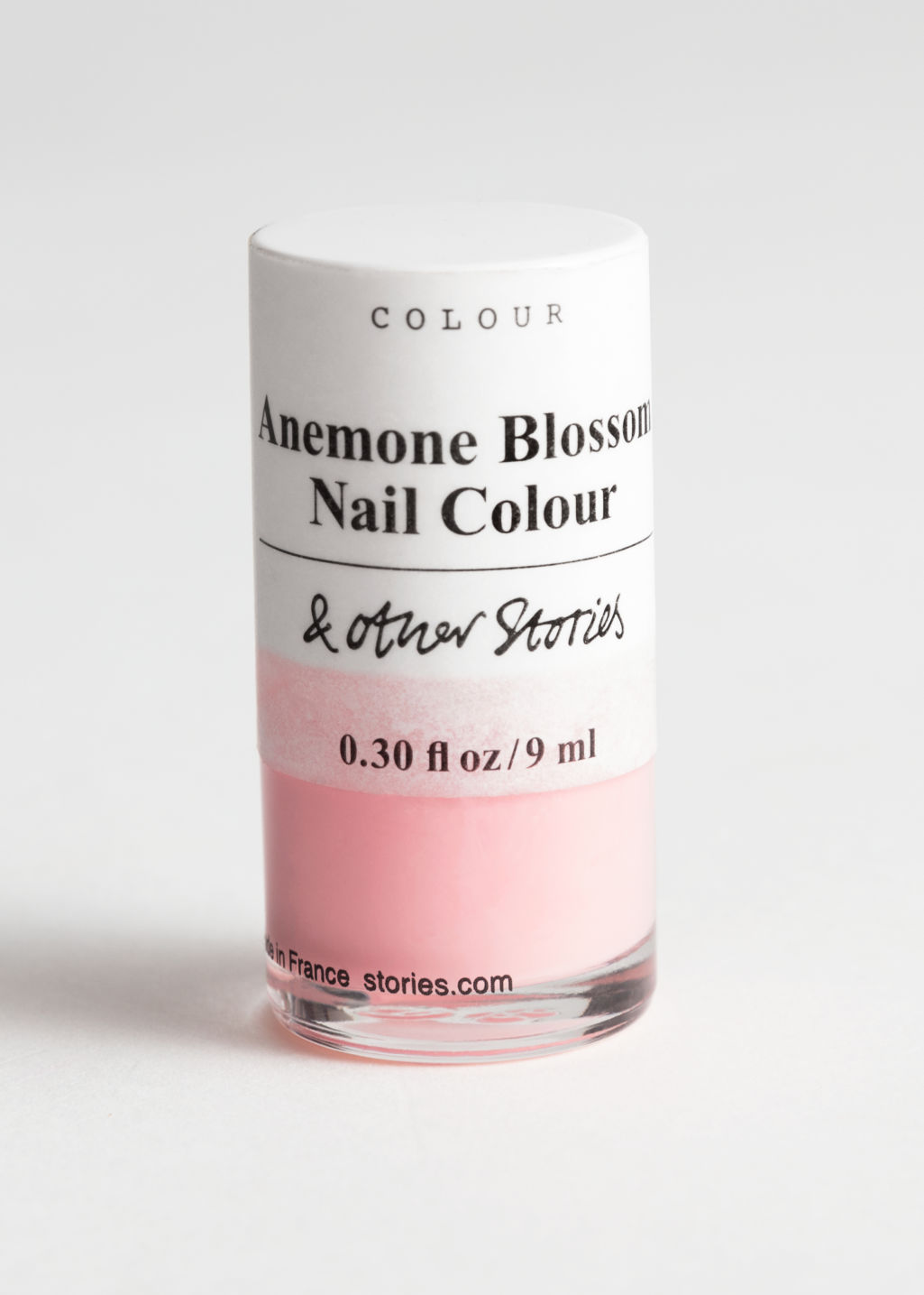 Front image of Stories nail polish  in orange