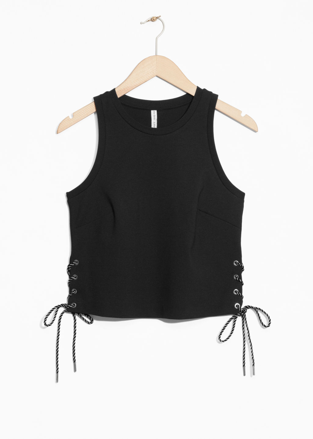 Front image of Stories lacing crop top in black