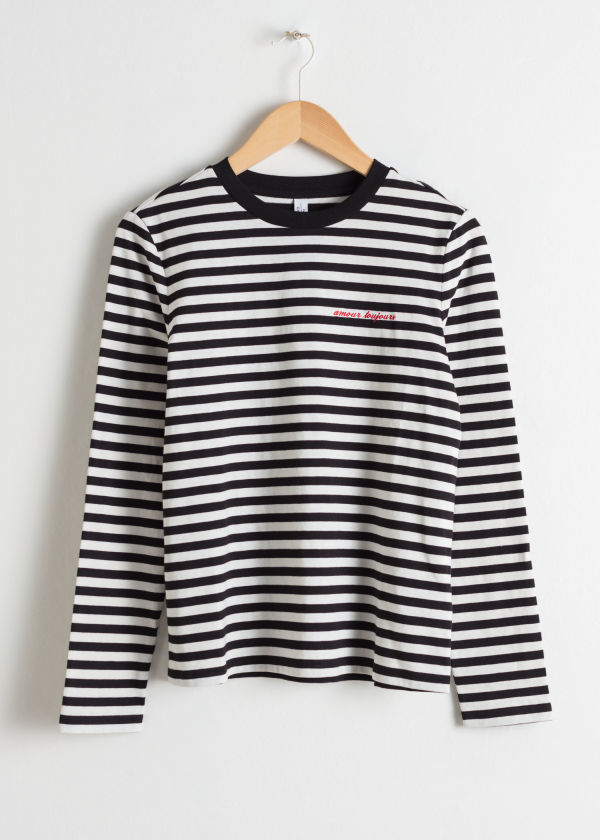Front image of Stories striped long sleeve tee in black
