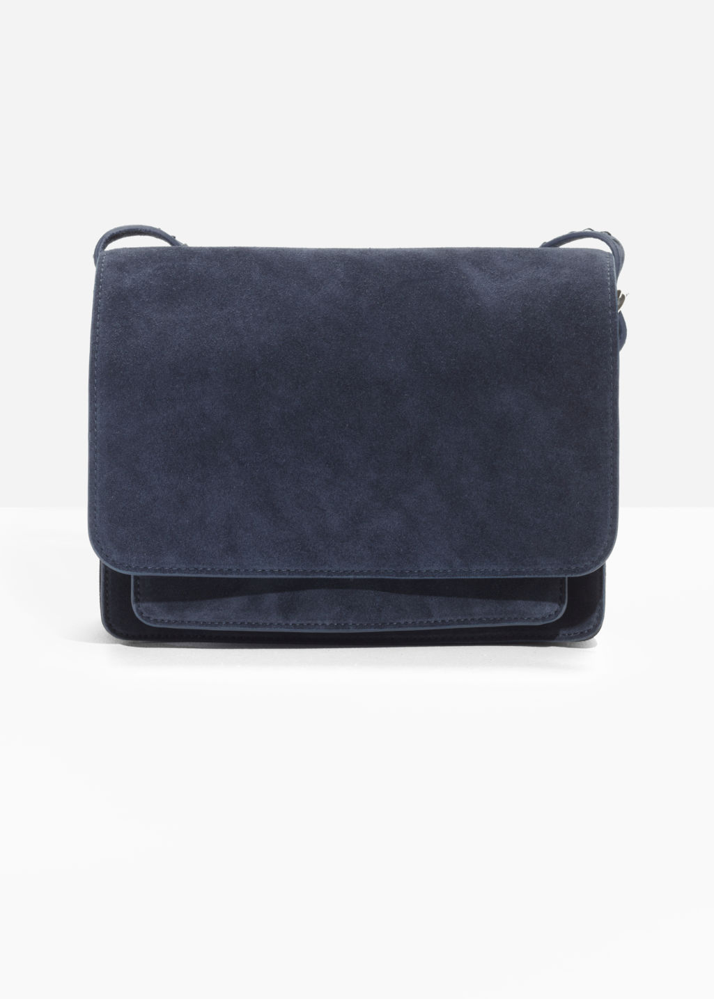 Front image of Stories suede messenger bag in blue