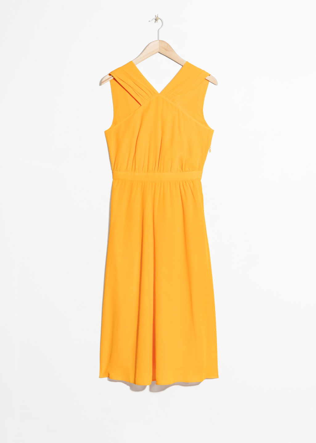Front image of Stories cross front dress in yellow