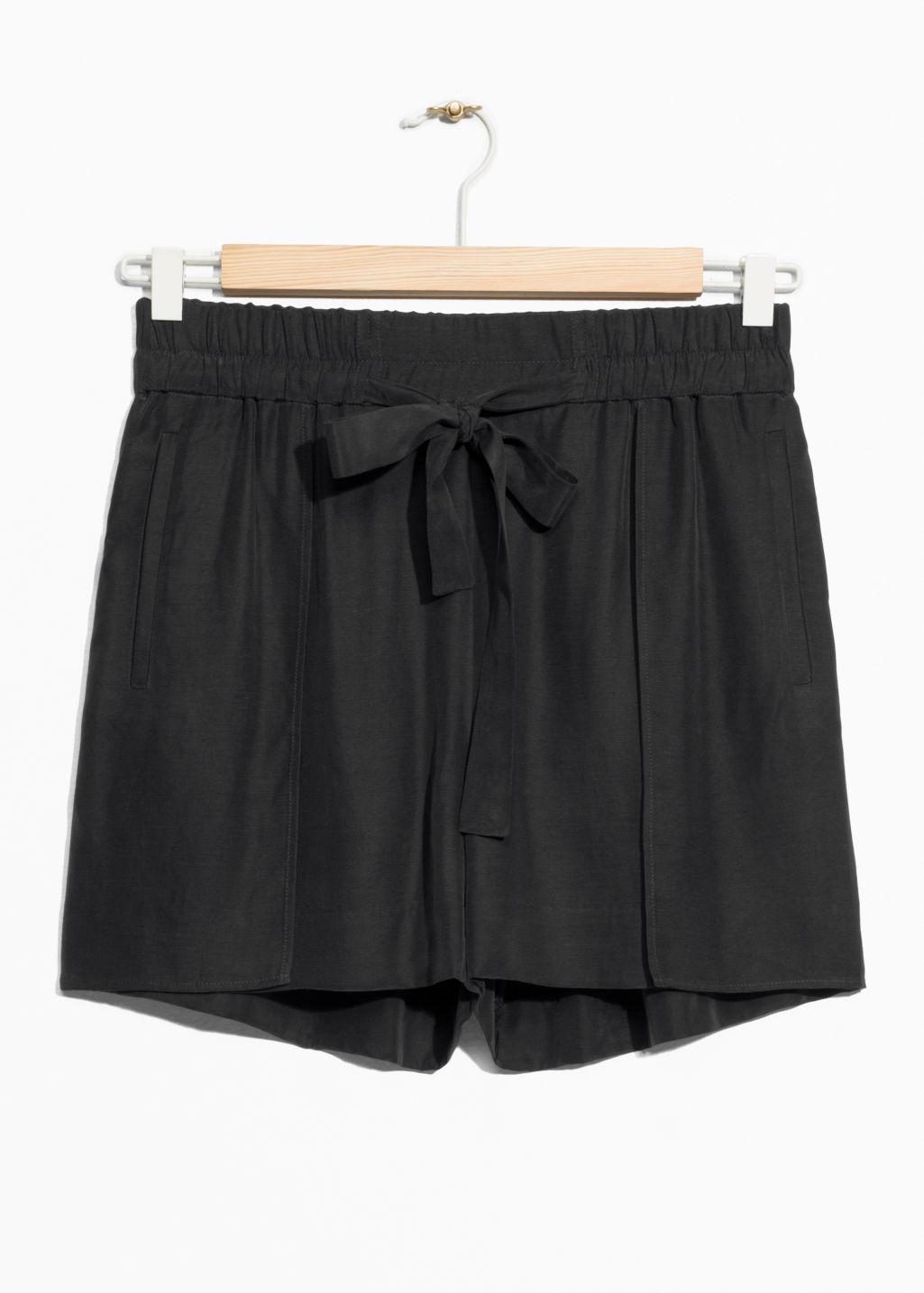 Front image of Stories tie-waist shorts in black