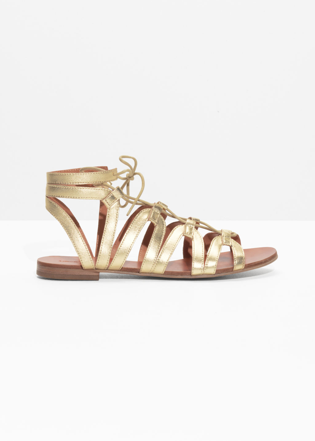 Front image of Stories lacing sandals in gold