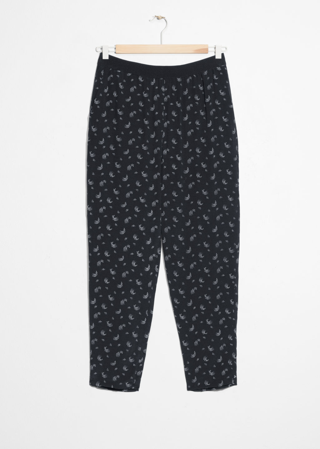 Front image of Stories cropped trousers in black