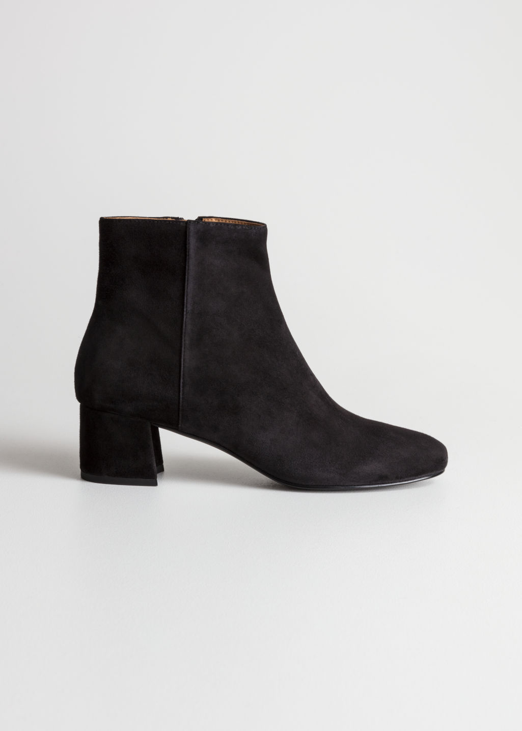 Front image of Stories caudry ankle boots in black