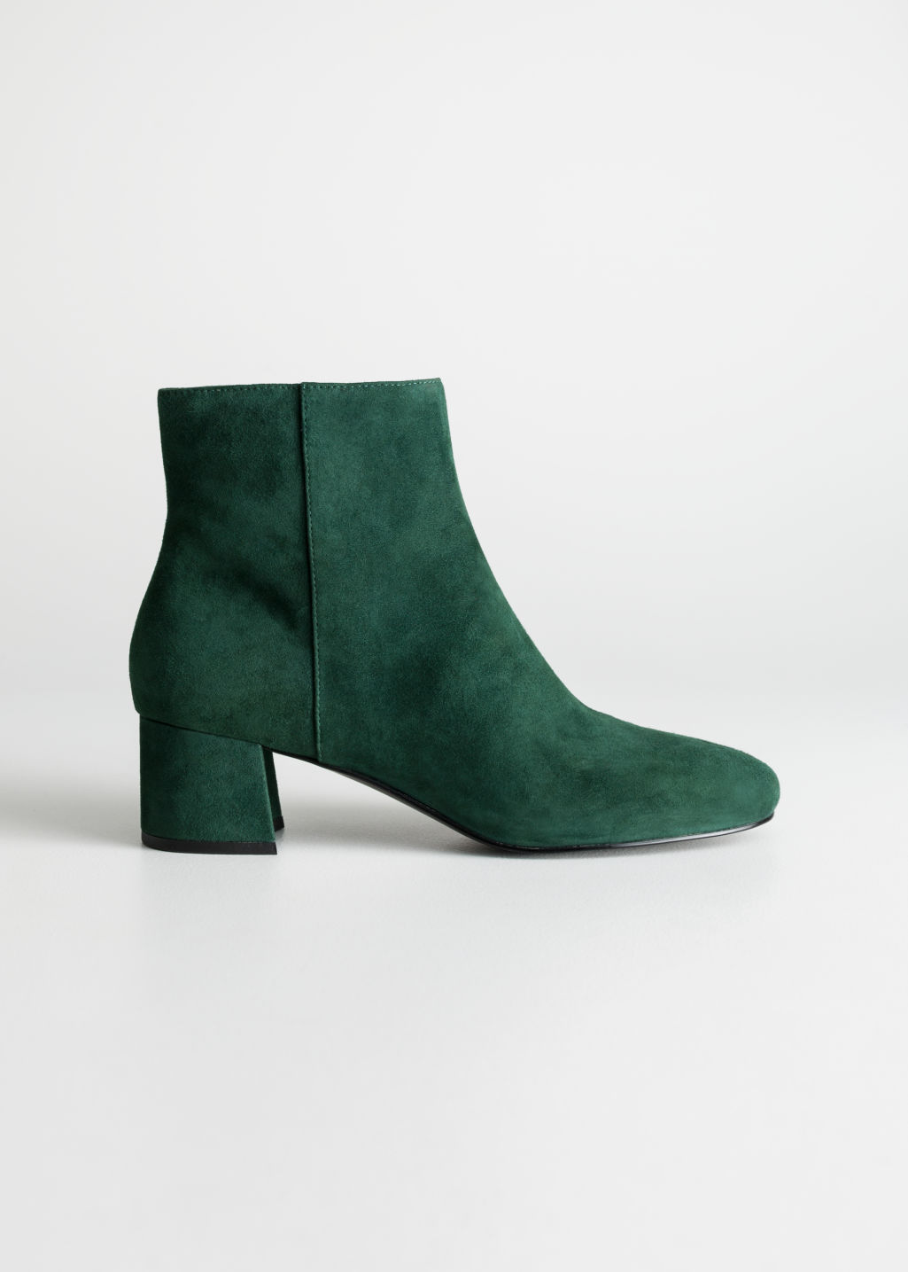 Front image of Stories ankle boots in green