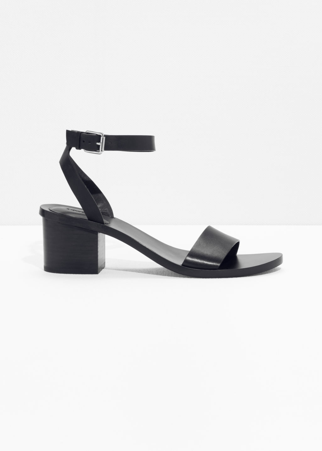 Front image of Stories ankle-strap heeled sandal in black