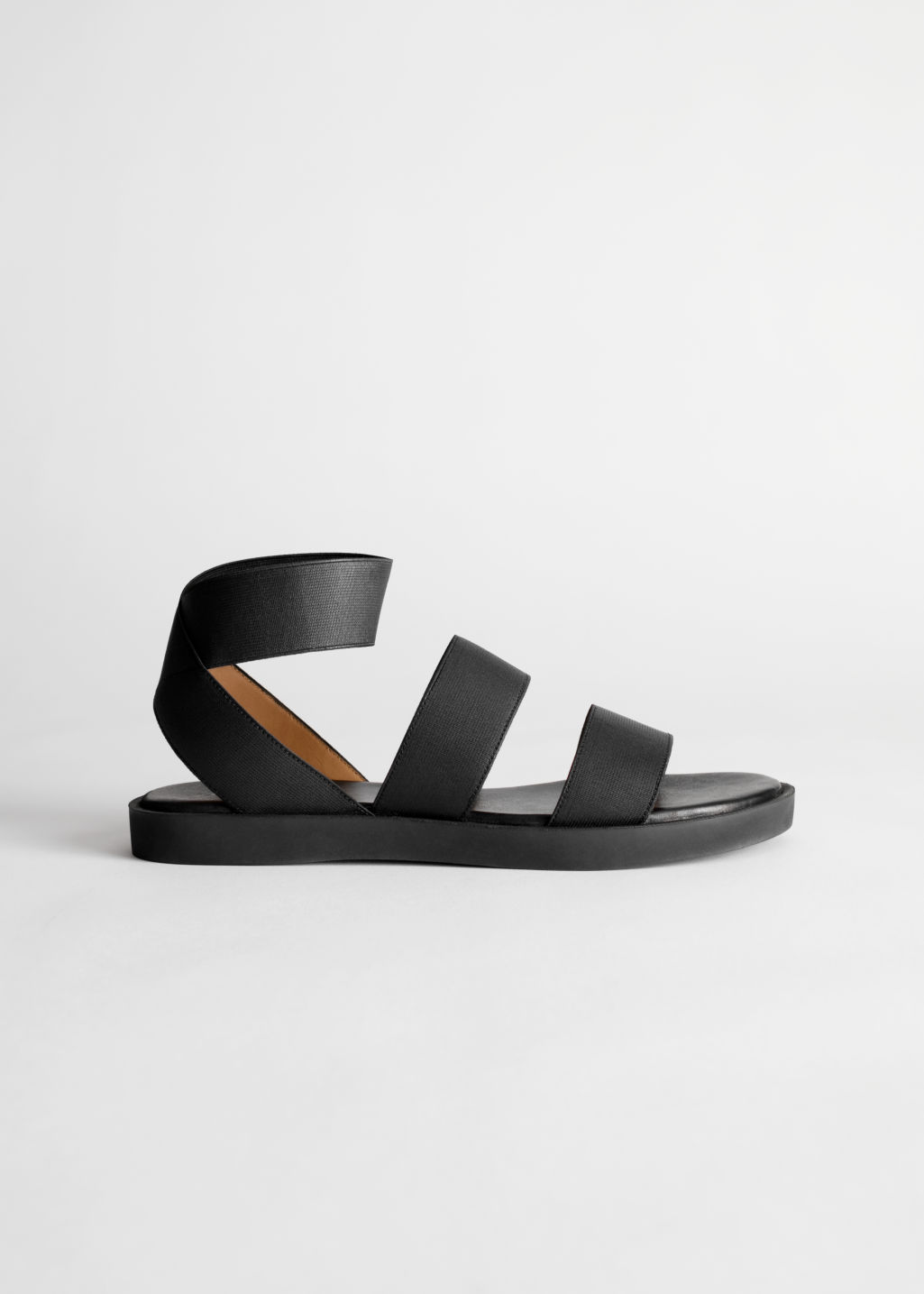 Front image of Stories elastic strap sandal in black