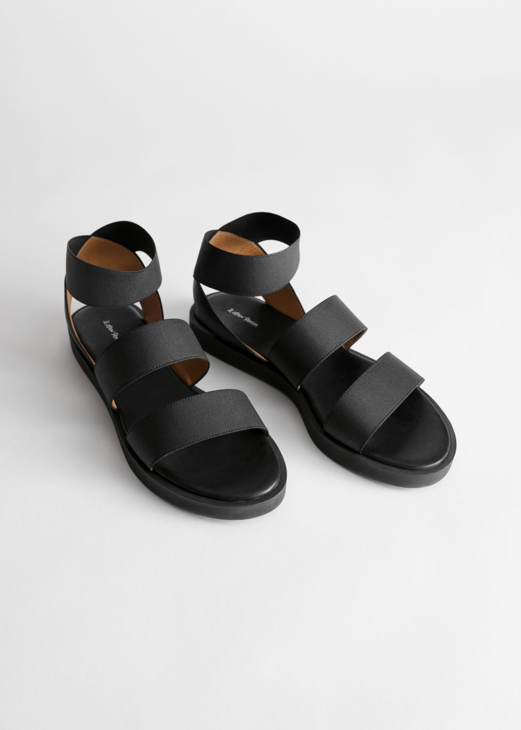 Back image of Stories elastic strap sandal in black