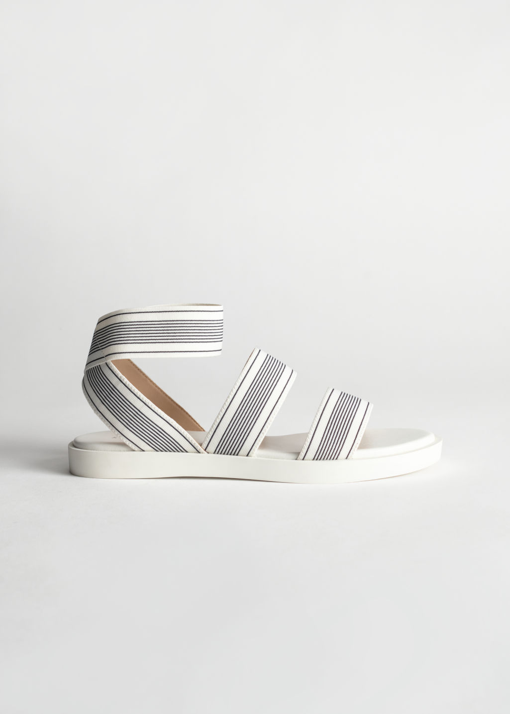Front image of Stories elastic strap sandal in white