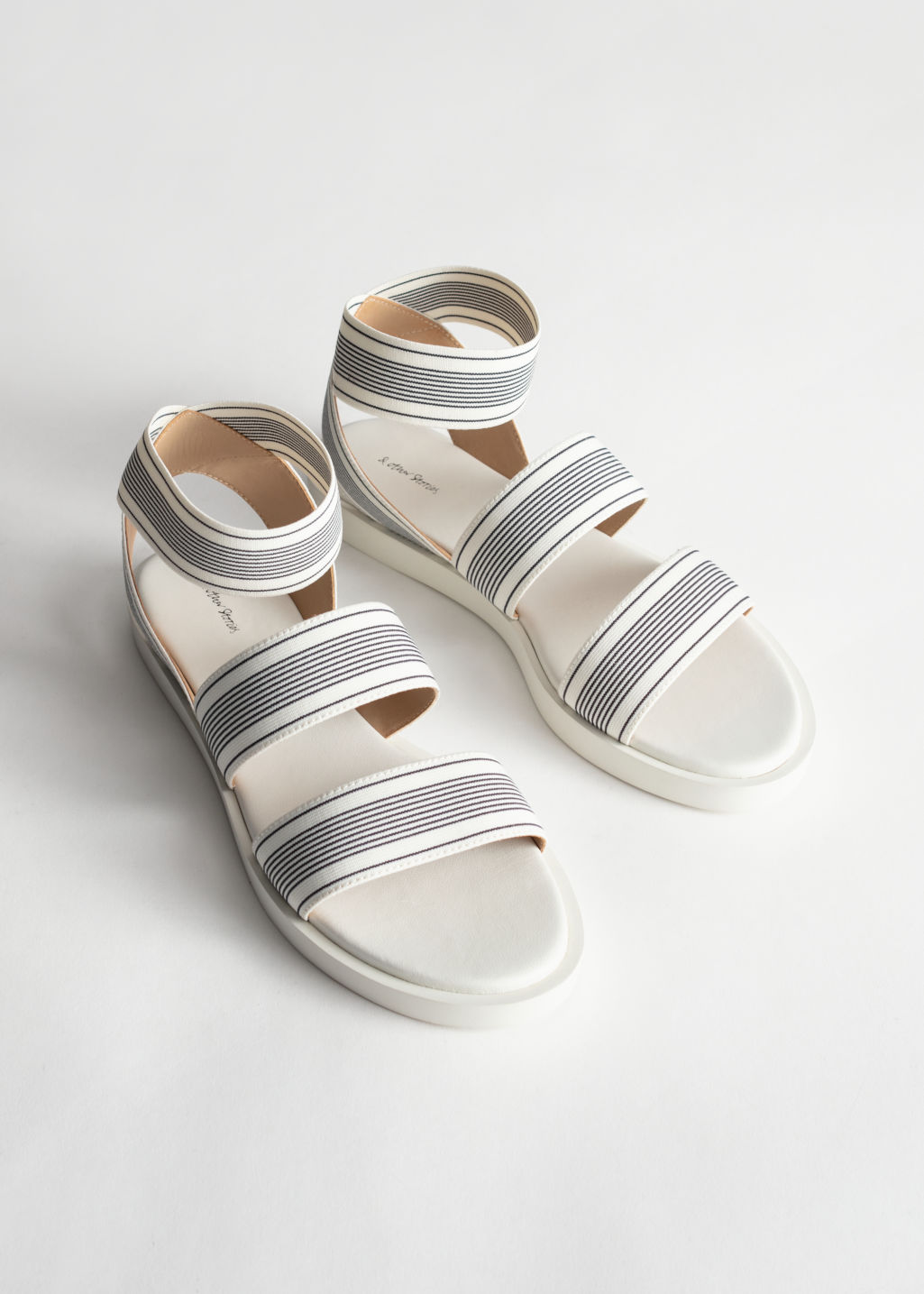 Back image of Stories elastic strap sandal in white