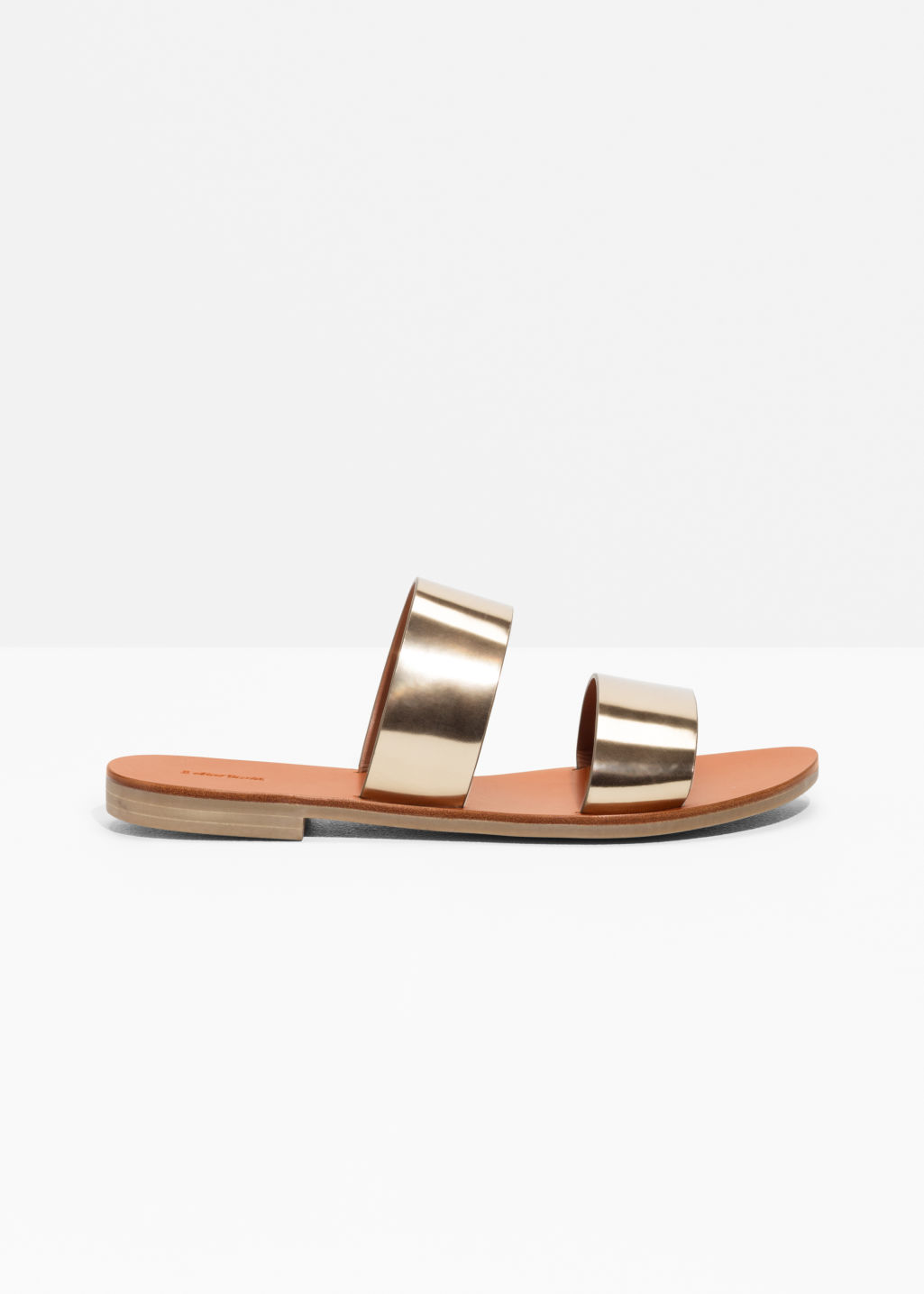 Front image of Stories two strap leather slip-on sandals in gold