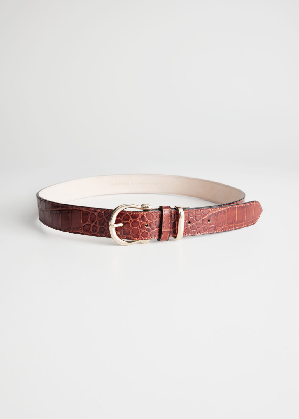 Front image of Stories croco leather belt in orange