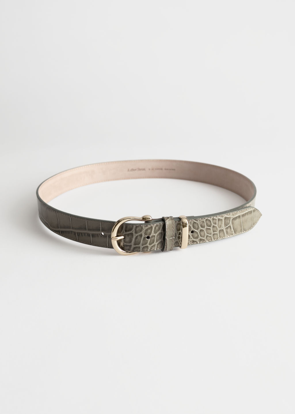 Front image of Stories croco leather belt in green