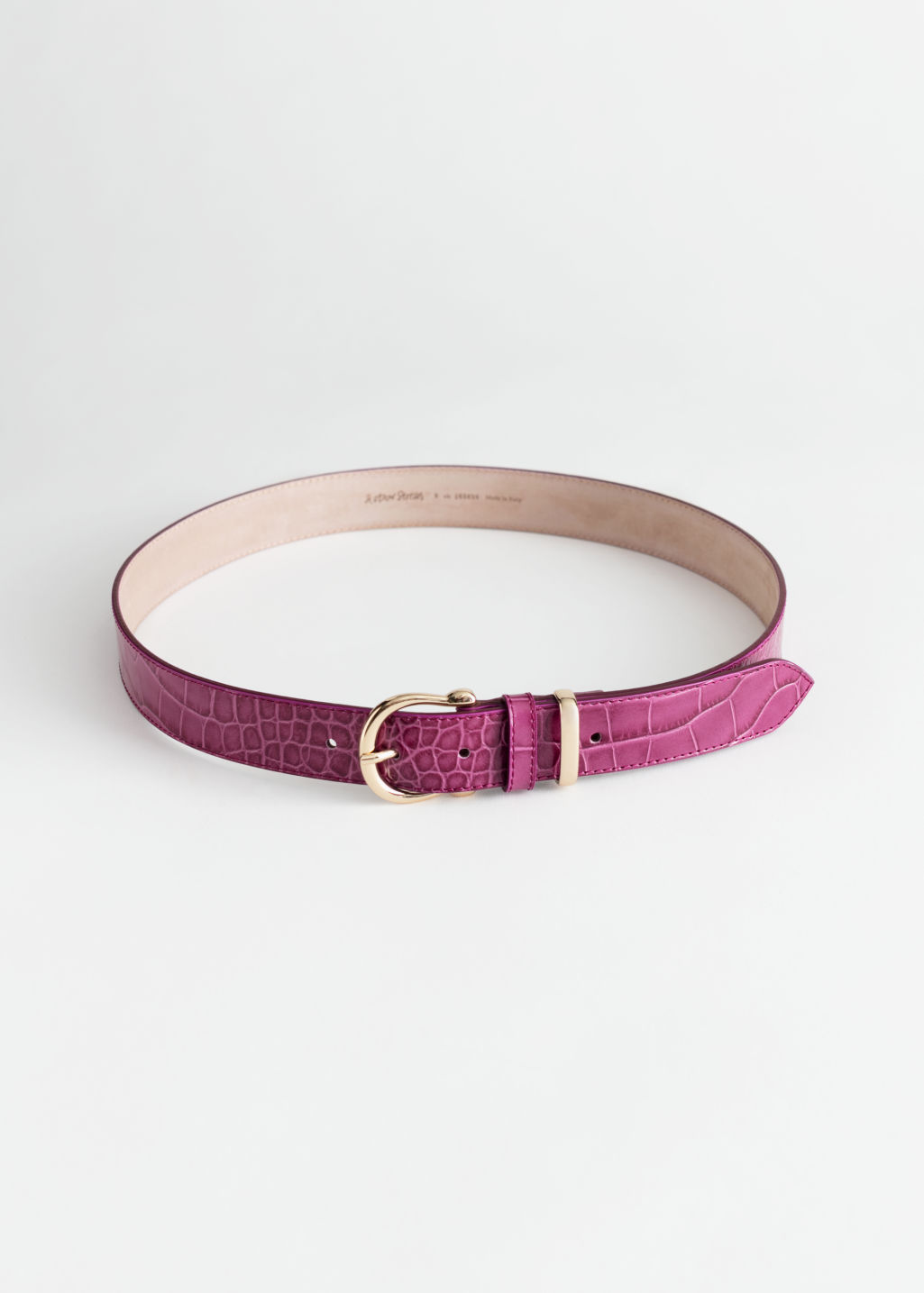 Front image of Stories croco leather belt in pink
