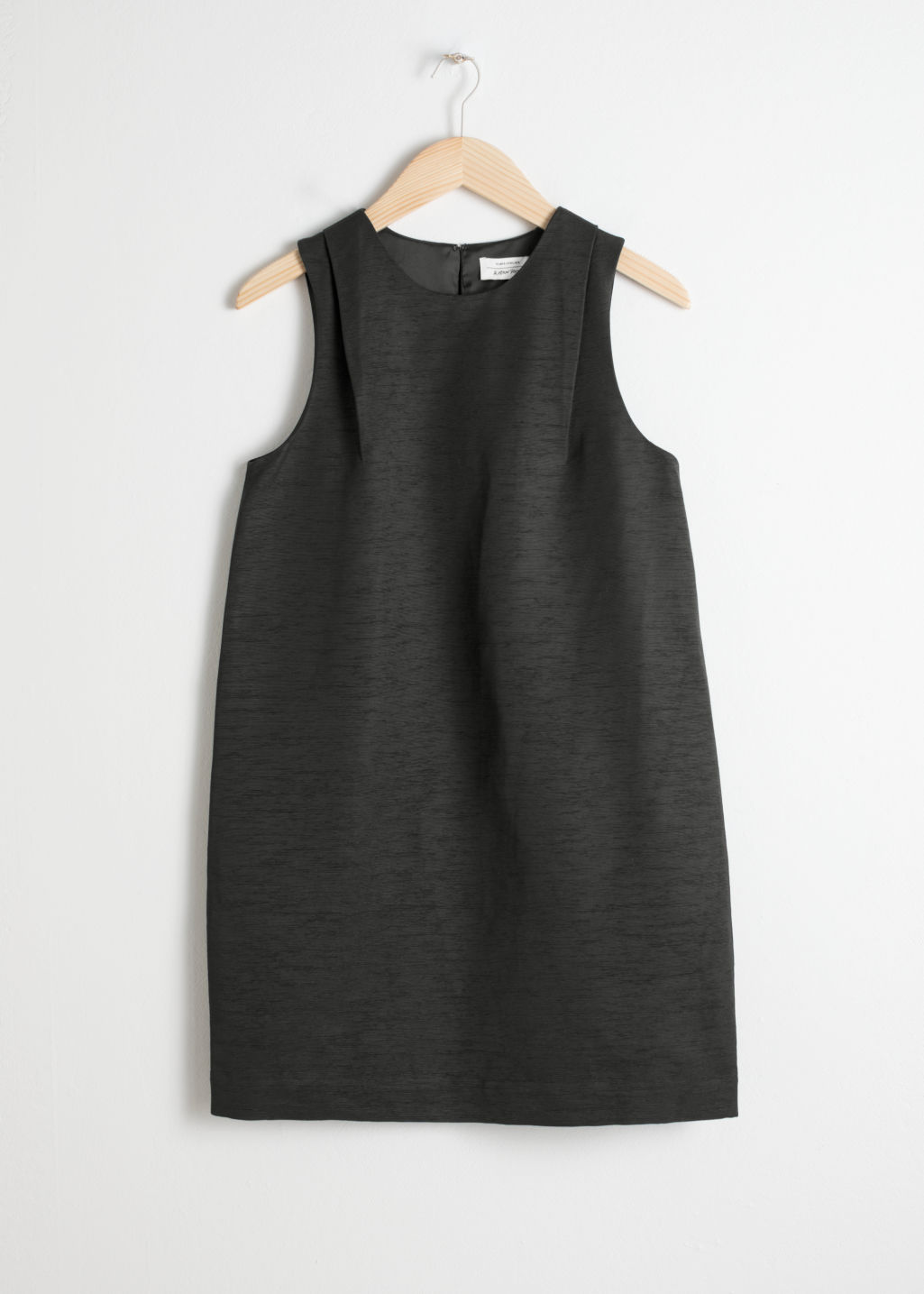 Front image of Stories sleeveless cocoon dress in black
