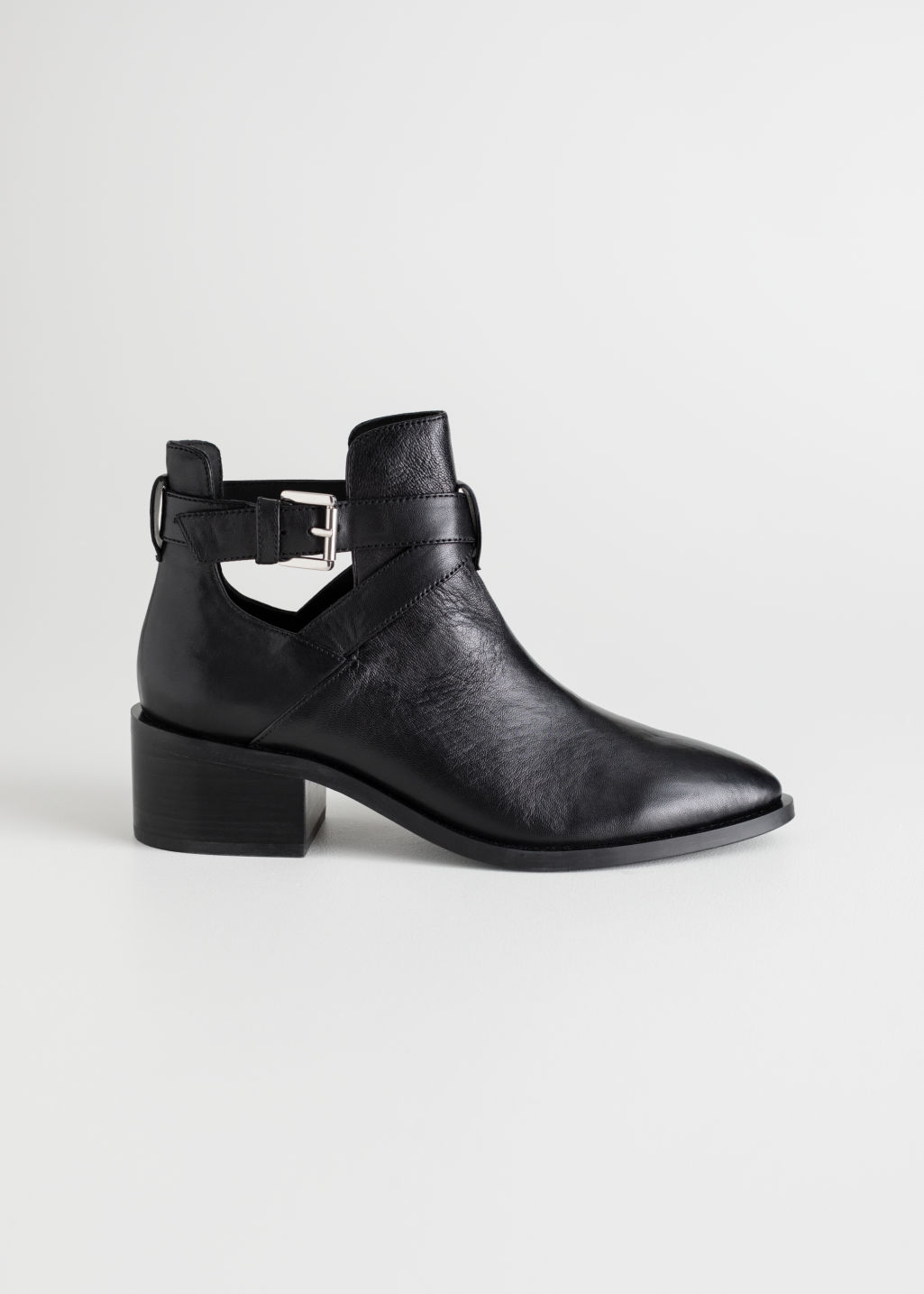 Front image of Stories cut out ankle boot in black