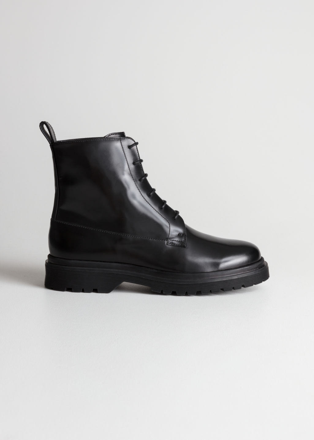 Front image of Stories lace-up leather boots in black