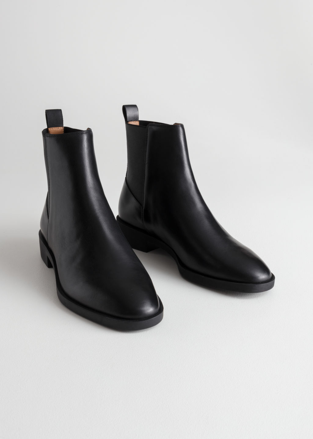 Back image of Stories chelsea leather boots in black