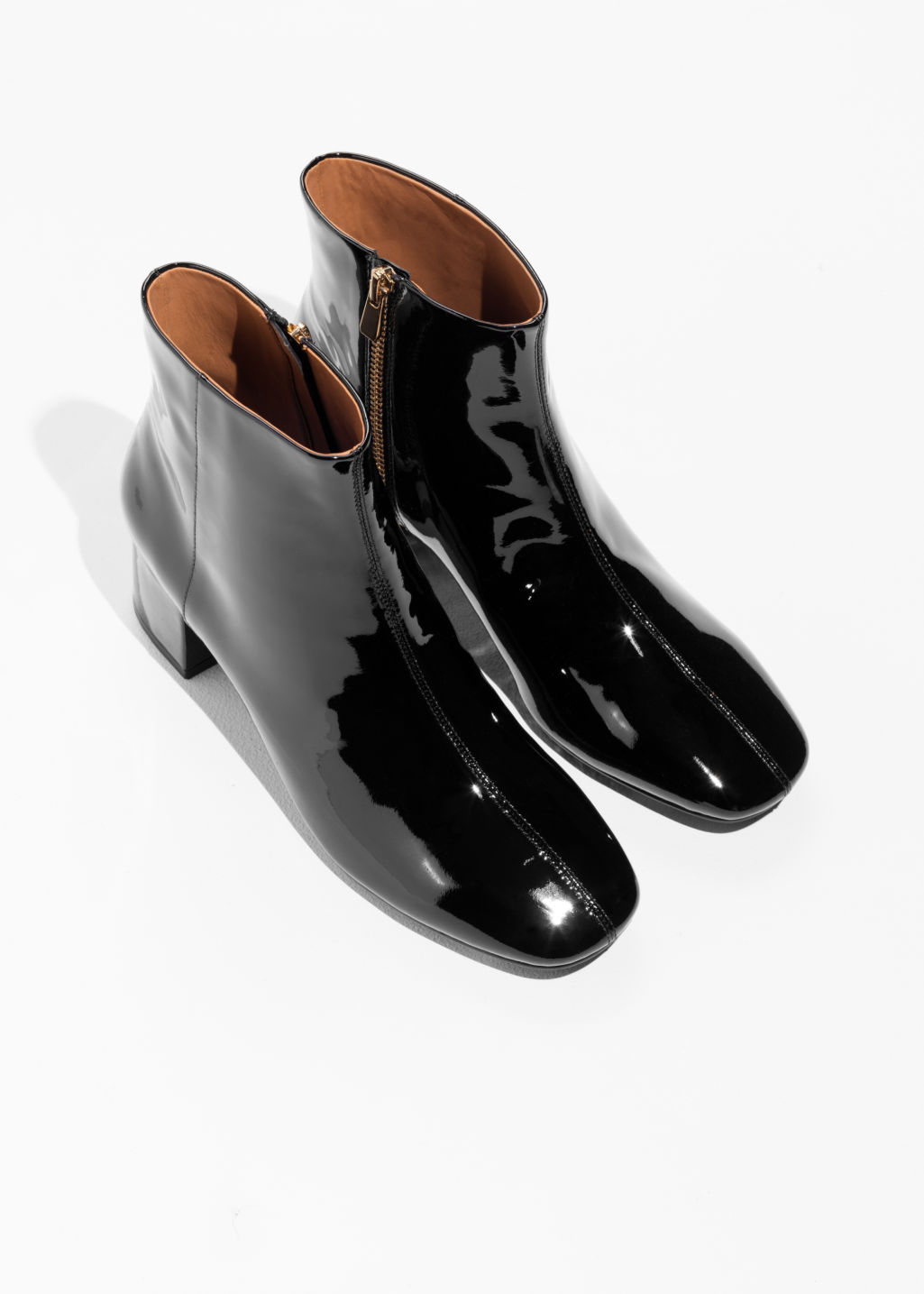 Back image of Stories patent leather ankle boots in black