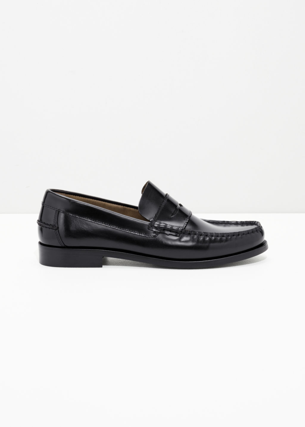 Front image of Stories leather penny loafer in black