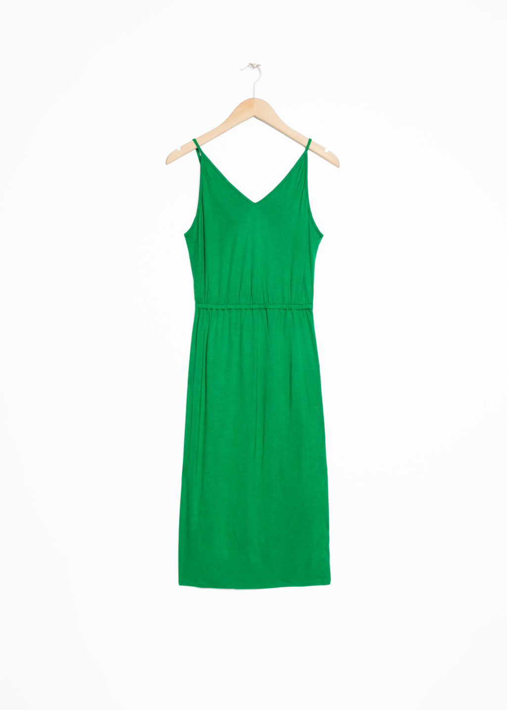 Front image of Stories tie back dress in green