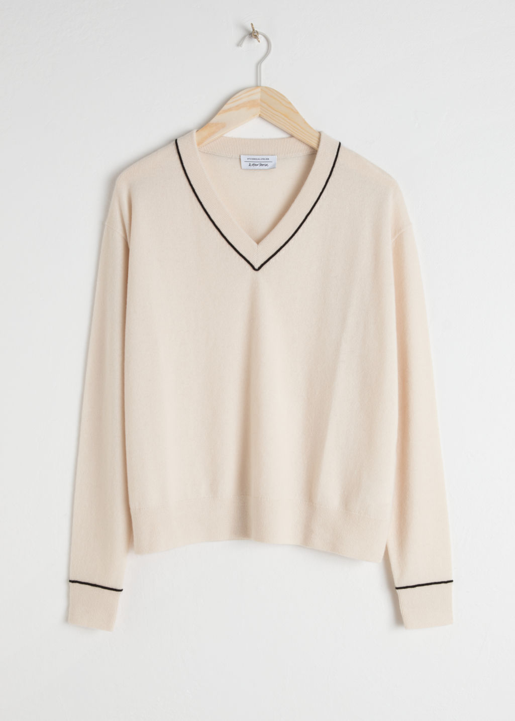 Front image of Stories cashmere knit sweater in beige