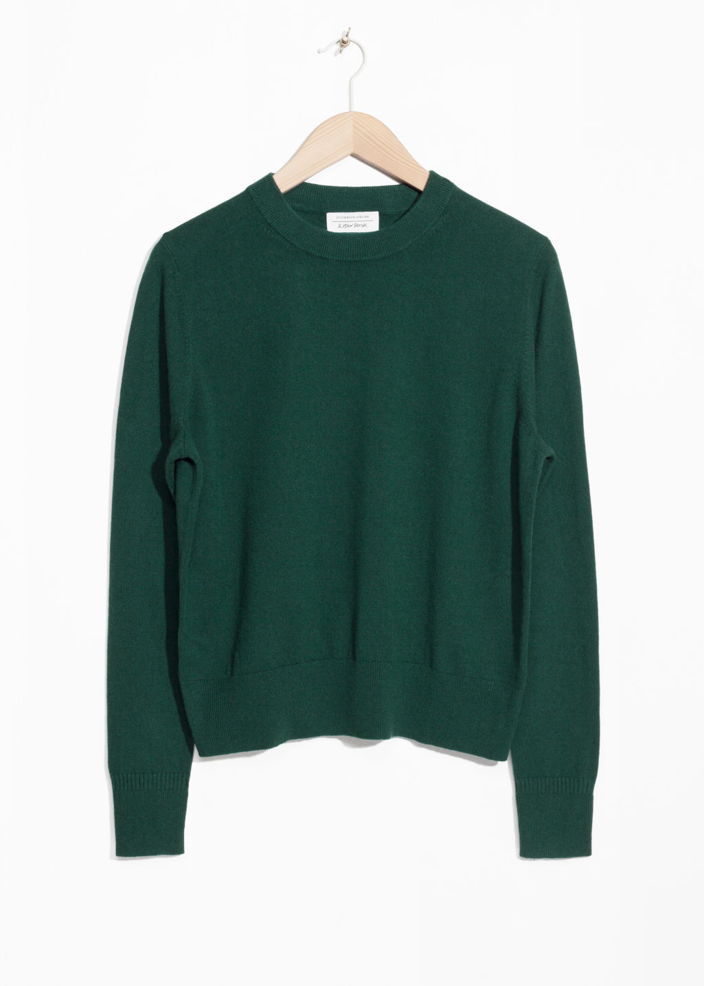 Front image of Stories cashmere knit sweater in green