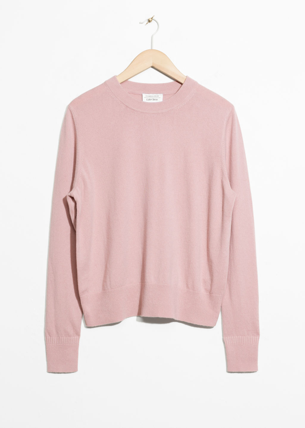 Front image of Stories cashmere knit sweater in pink