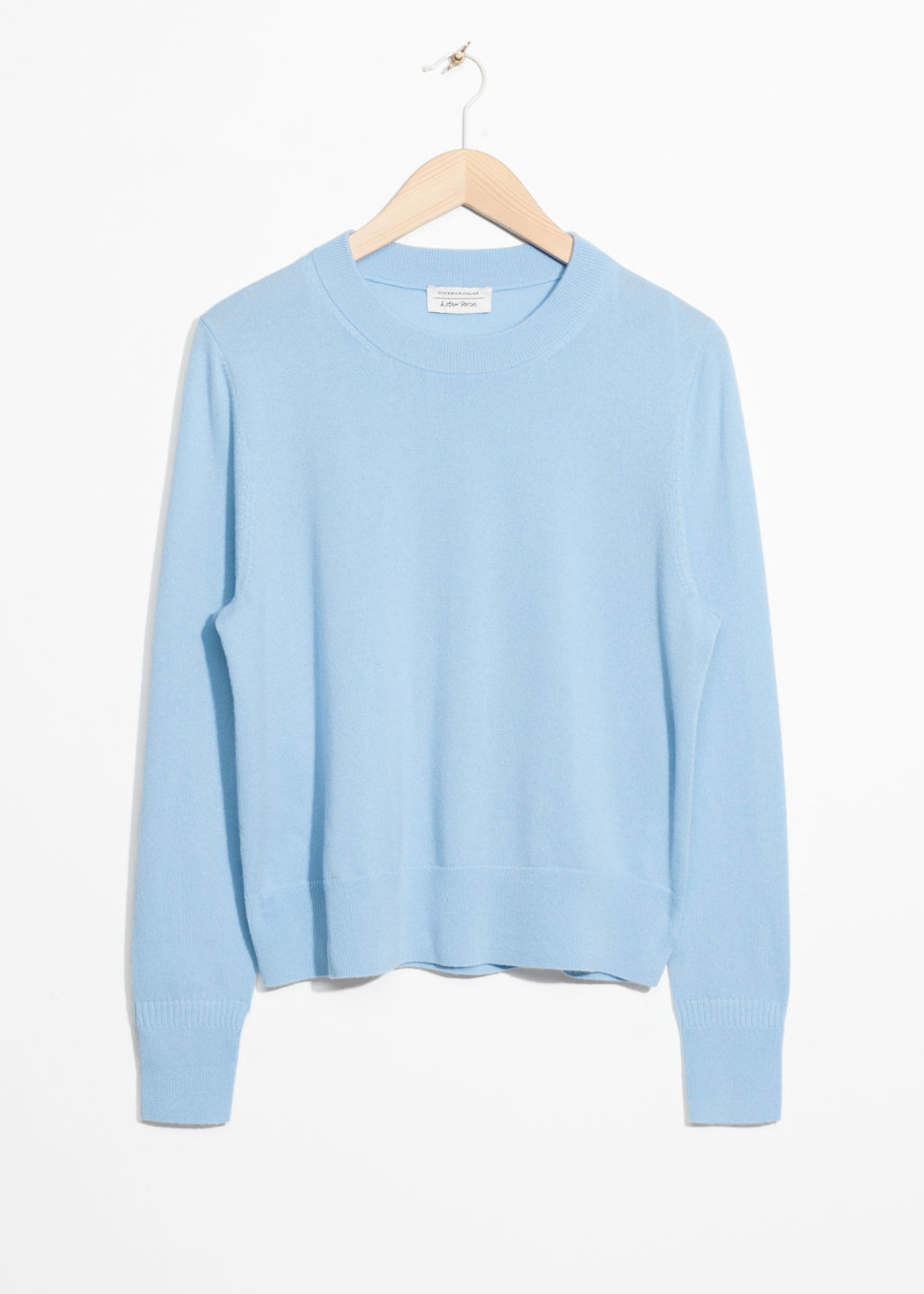 Front image of Stories cashmere knit sweater in blue
