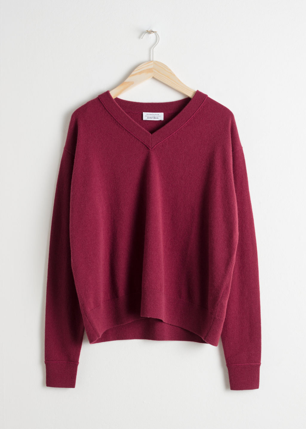 Front image of Stories cashmere knit sweater in red