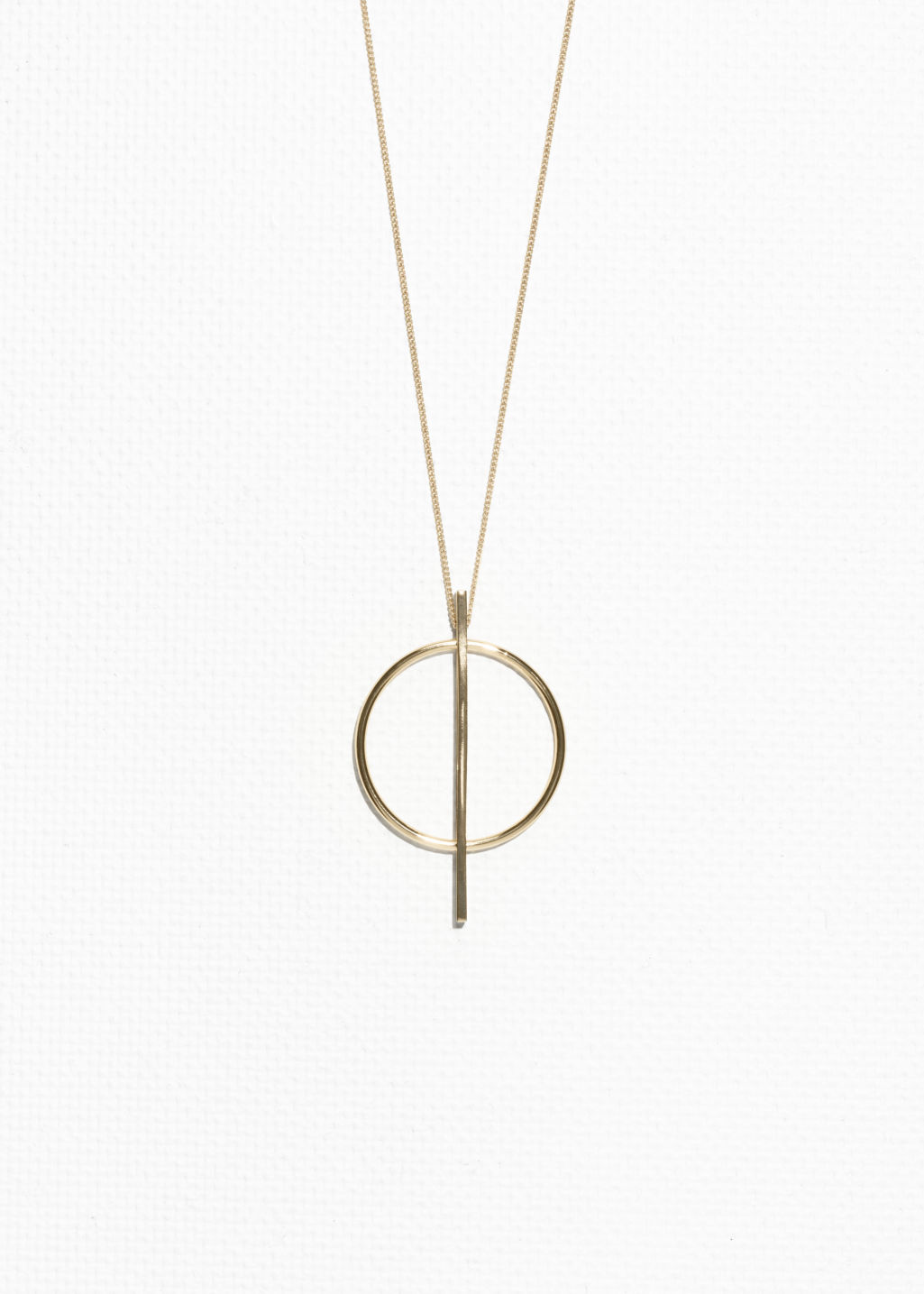 Front image of Stories geometric circle necklace in gold