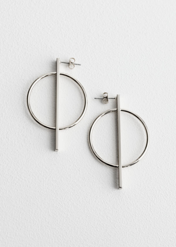 Front image of Stories geometric shapes earrings in silver