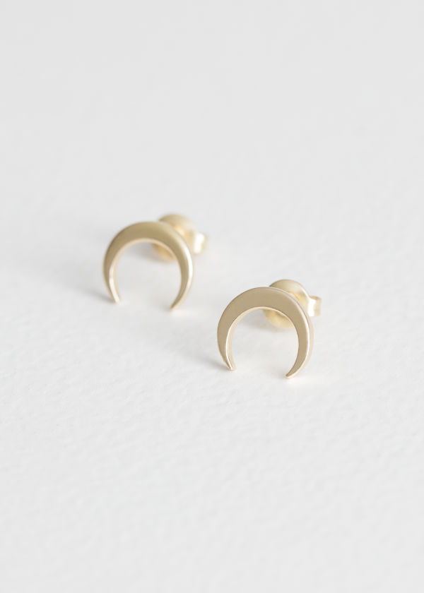 Front image of Stories crescent moon studs in gold