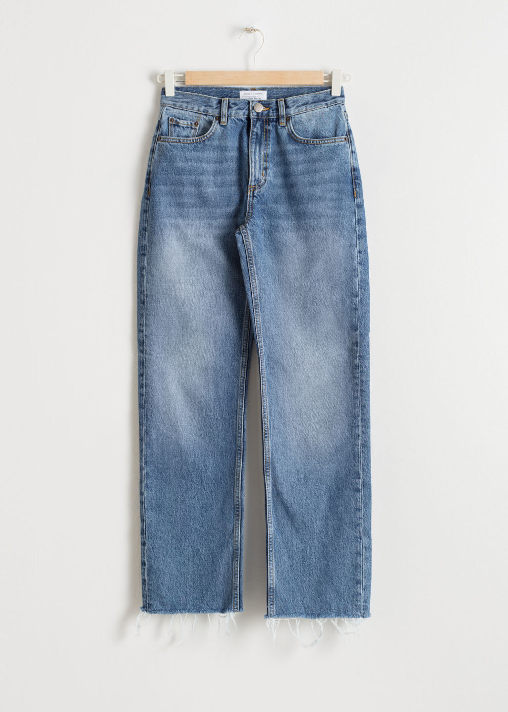 Front image of Stories raw edge denim jeans in blue