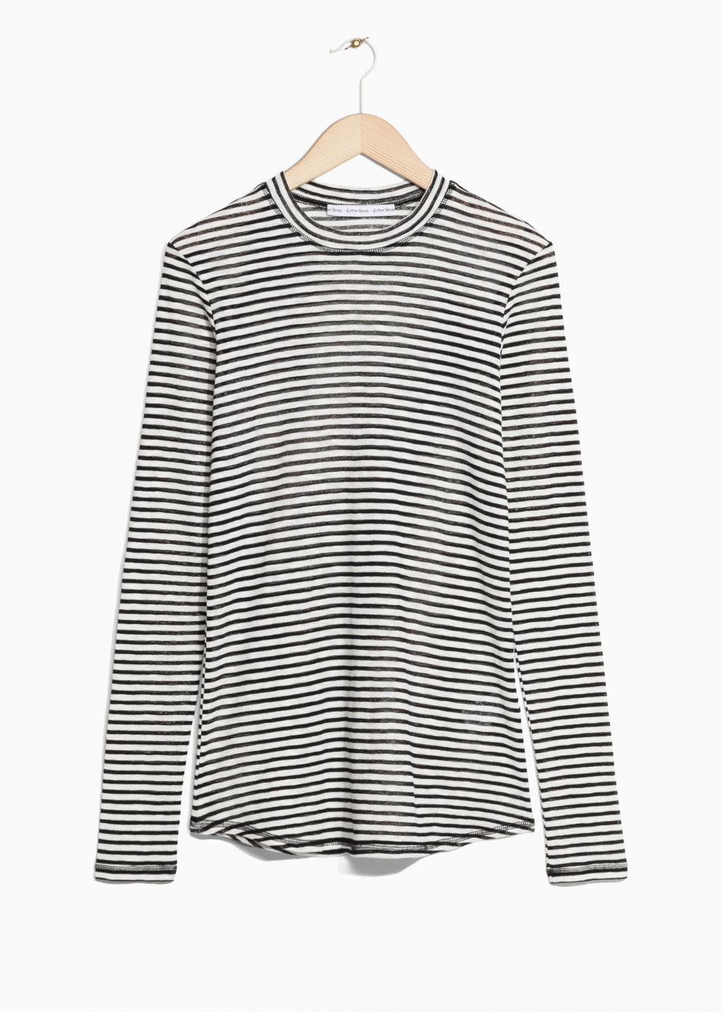 Front image of Stories sheer striped top in black