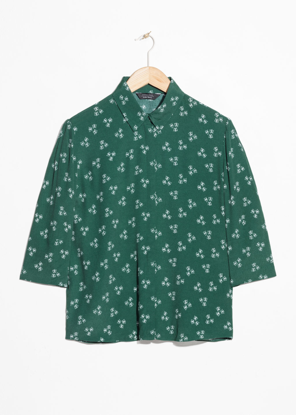 Front image of Stories spackle print shirt  in green