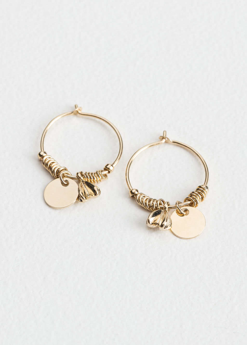 Front image of Stories ornament hoops  in gold