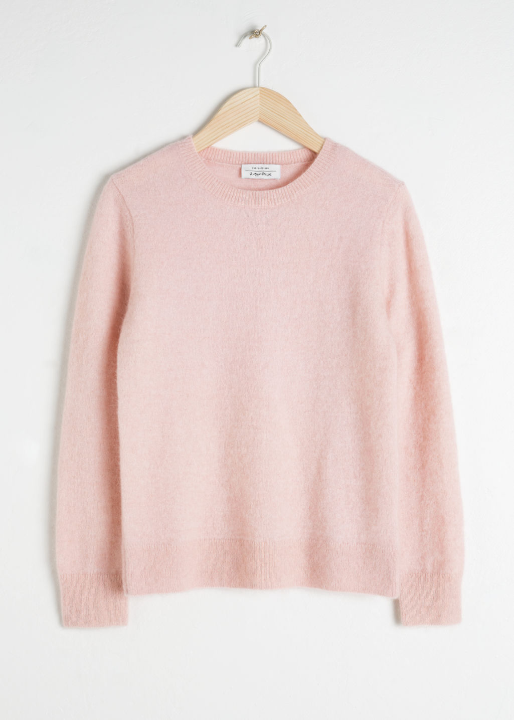 Front image of Stories wool blend knit sweater in pink