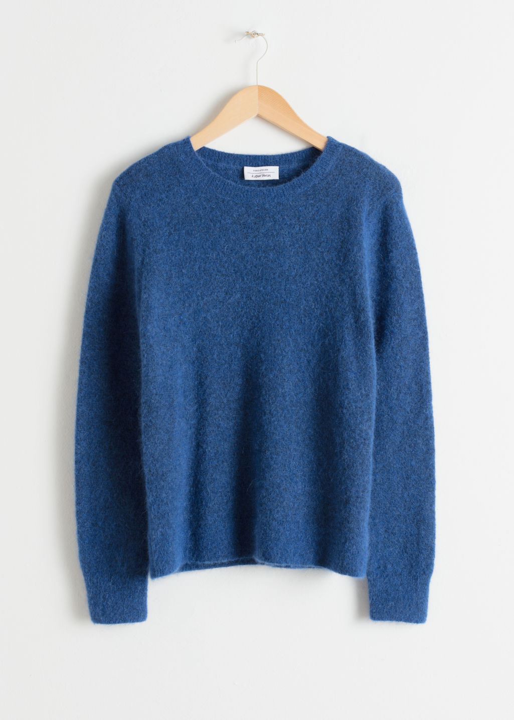 Front image of Stories wool blend knit sweater in blue