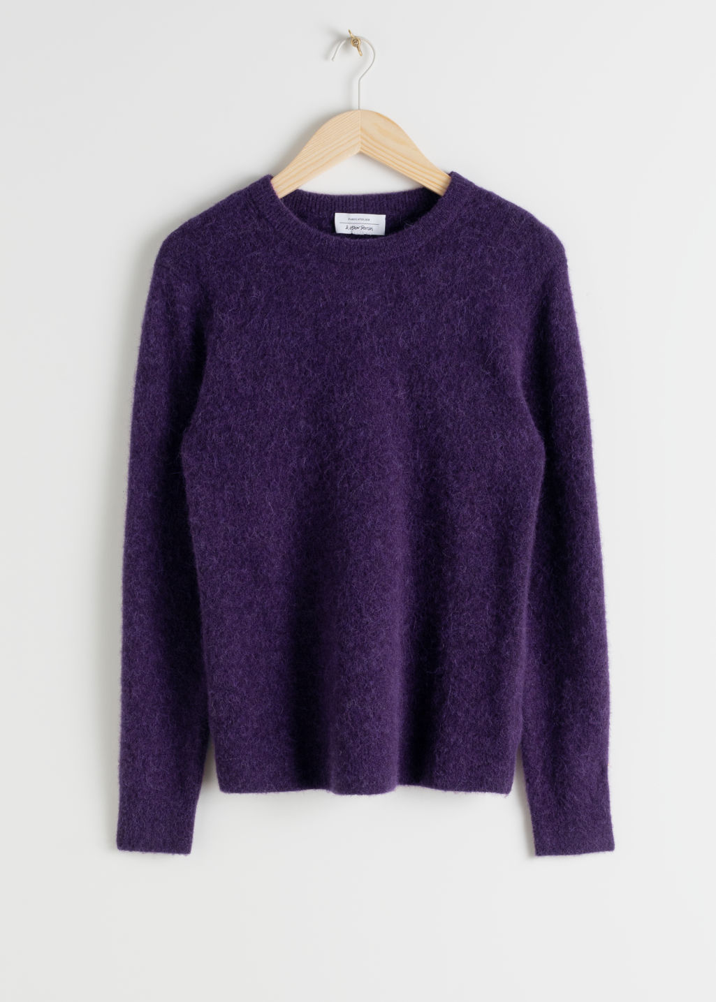 Front image of Stories wool blend knit sweater in purple