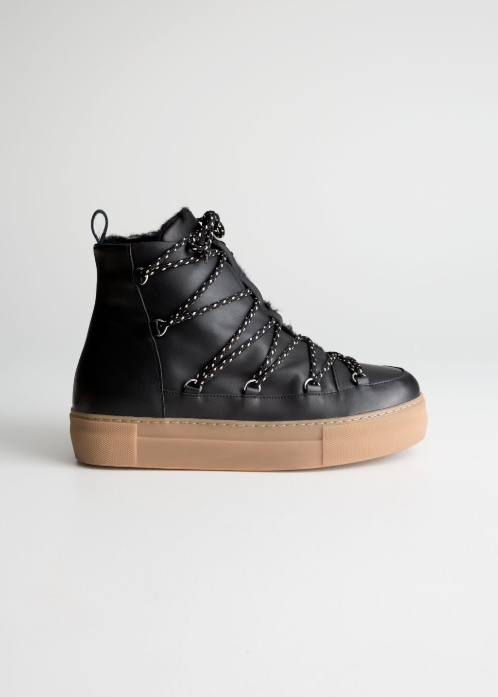 Front image of Stories leather snow boots in black