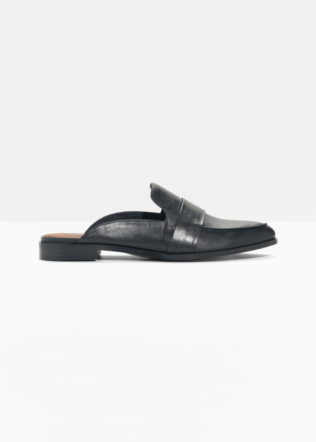 Front image of Stories slipper leather loafers in black