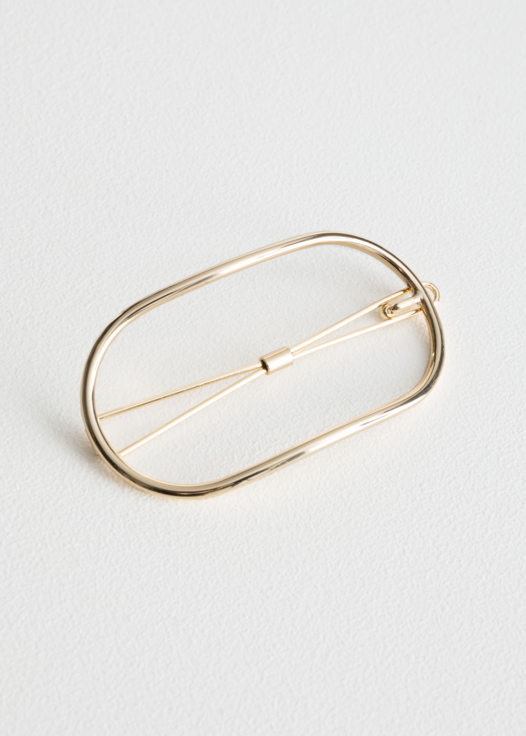 Front image of Stories open-frame hair clip in gold